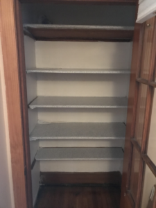 old closet shelving in a house in woburn ma