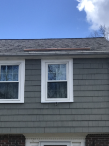 rain-diverter-attached-to-a-roof-above-a-front-door