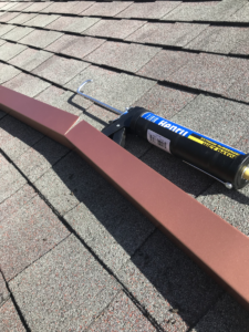 roof-rain-diverter-being-sealed-with-roof-sealant