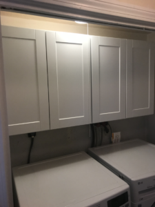 wall-cabinets-hanging-above-washer-and-dryer-machines