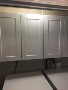 white-cabinets-hung-in-a-laundry-closet
