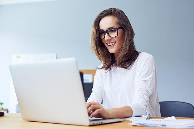 happy homeowner on laptop